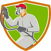 Illustration of car painter wearing face mask holding paint spray gun spraying viewed from the side set inside shield crest done in retro style. poster