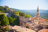 View of Saint Saturnin d Apt Provence France. Skyline with The Cathedral roof poster