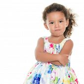 Cute and funny small hispanic girl making an angry face isolated on white poster