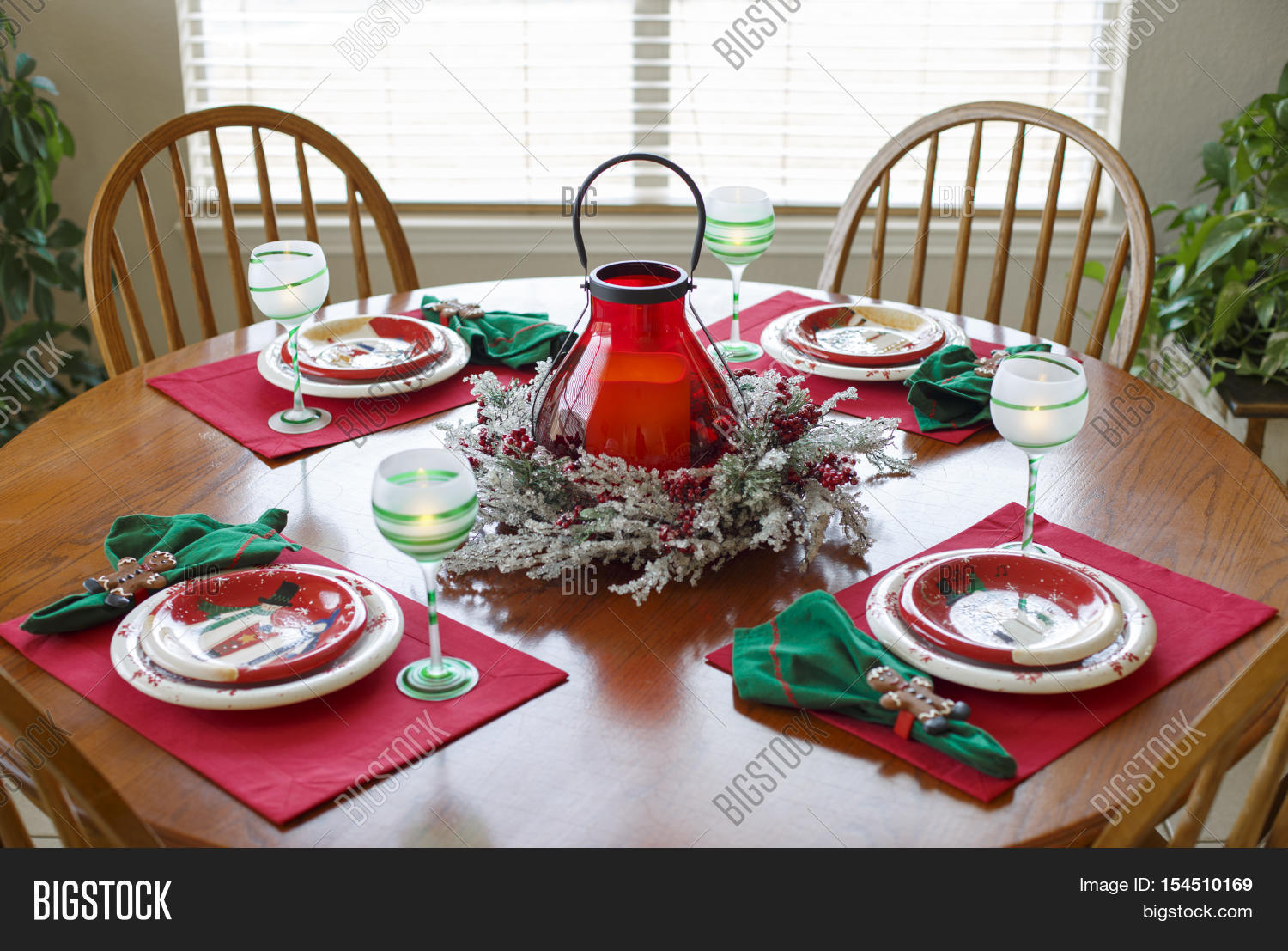 Christmas Holiday Dining Dinner Setting Arrangement Table. Christmas dinner set for four on the round & Christmas Holiday Image u0026 Photo (Free Trial) | Bigstock