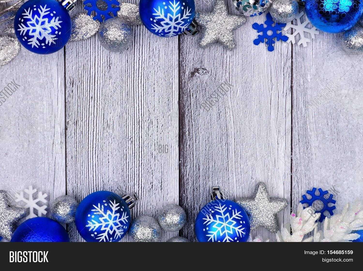 blue and silver christmas ornament double border with snow frame on a rustic white wood background - Blue And Silver Christmas