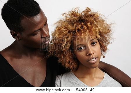 Happy To Be Together. Beautiful Young African Couple Standing Close To Each Other On White Studio Wa