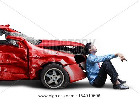 Picture of frustrated businessman with broken car after traffic accident isolated on white background