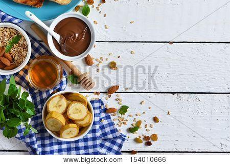 Good morning - toast with walnut chocolate paste banana and honey. White food background.
