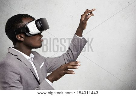 Technology, Innovation, Cyberspace And Gaming. Profile Of Fascinated Dark-skinned Businessman In Ele