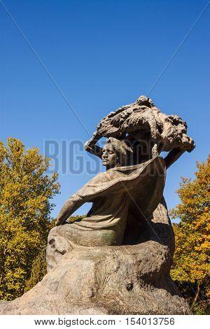Warsaw Poland - October 10 2015: Frederic Chopin monument in Lazienki park (Royal Baths park). Designed in 1907 by Waclaw Szymanowski.