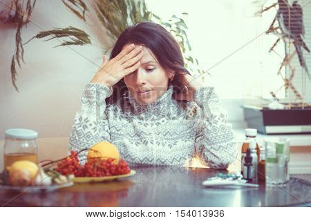 Sick man with drugs and fruit on table