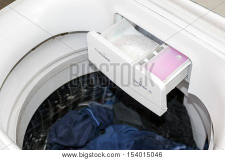 Detergent and fabric softener in the washing machine.