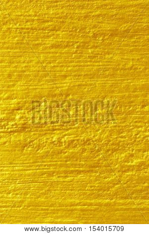 The gold paint on cement wall texture.