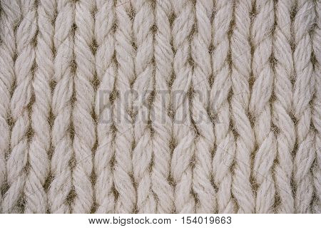 Macro flat view of knitted undyed wool surface