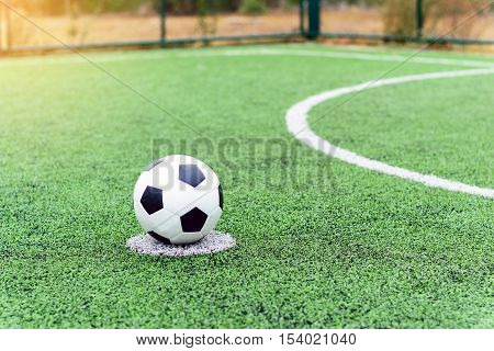 Place the ball on the spot for a penalty on the football field.