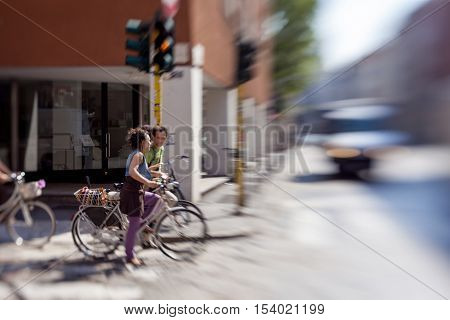 MILAN, ITALY-MAY 28, 2012: cyclists are at a crossroads, roadway motion blur