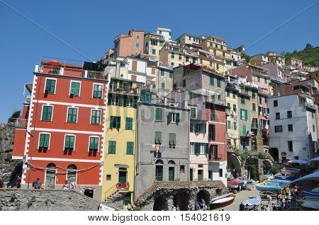 view of Riomaggiore one of the five famous fisherman villages of Cinque Terre in Liguria Italy