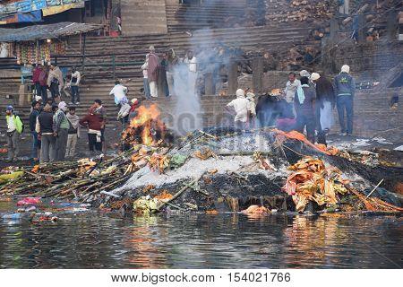 VARANASI, UTTAR PRADESH, INDIA - FEBRUARY 17, 2016 - Burning dead bodies, ashes and smoke on the ghats of Varanasi