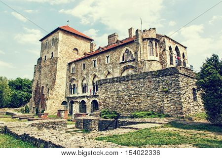 Beautiful castle in Tata Hungary. Travel destination. Architectural theme. Beautiful place. Retro photo filter. Historic object.