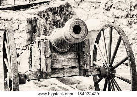 Close up photo of historic cannon. Retro object. Military theme. Black and white photo.