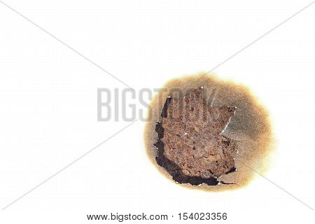 burnt paper lying on a rusty metal. used as a brush for designers.