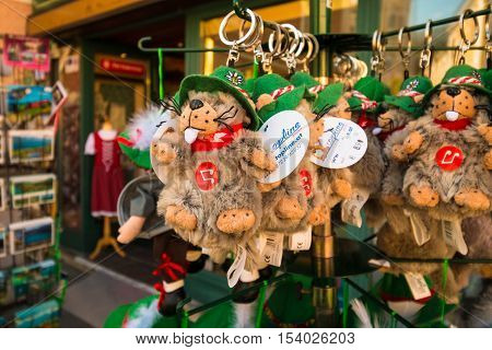 Mondsee Austria - August 25 2016: Alpine marmot - typical austrian animal as a stuffed toy in traditional austrian hat for sale in a souvenir shop.