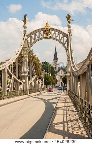 Laufen Germany - August 30 2016: Bridge from Laufen (Bavaria Germany) to Oberndorf bei Salzburg (Austria) over Salzach river. The bridge connects two european countries.