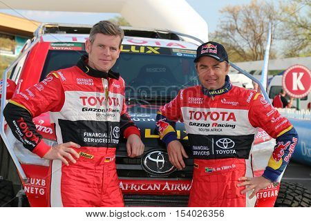 Giniel De Villiers And Navigator, Dirk Von Zitzewitz In Front Of The New Toyota Hilux Evo 2