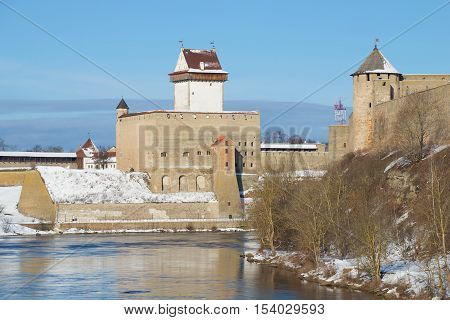 View of the old Herman castle from the Russian side of the Narva river, sunny March day. Estonia