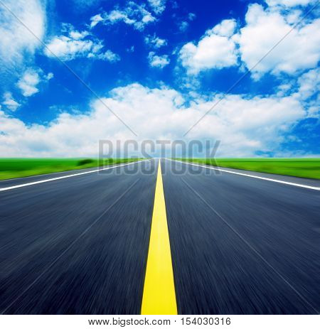 Expressway leads to blue sky, fantastic rural landscape, exaggerated expression.