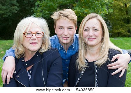 Mature Mother And Daughter With Grand Son Outside