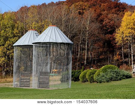 Two empty wire corn cribs on a Wisconsin dairy farm