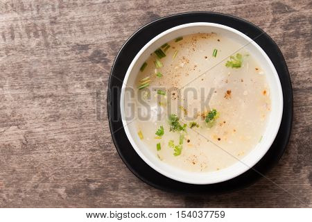 rice gruel on wood table , top view