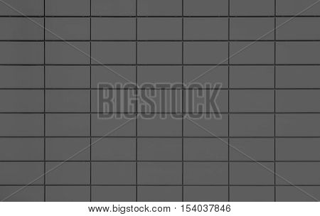 View of a Dark grey tiled wall suitable for backgrounds