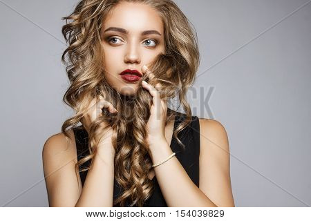 Close Portrait Of A Beautiful Girl With A Professional Make-up And Hairstyle. Attractive Face Of A Y
