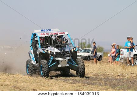 Speeding Blue And White Maverick 1000T Turbo Rally Car Front View