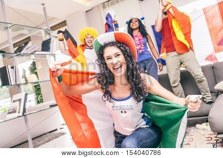 Italian fan supporting her team - Friendswatching a sport event on tv at home