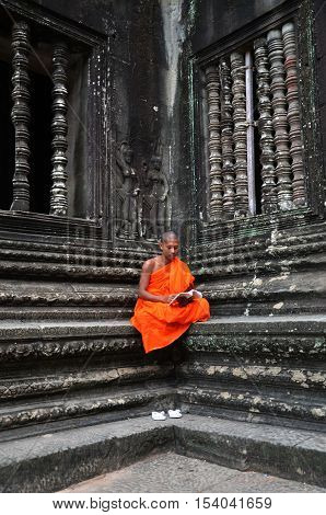Monk Meditates At The Angkor Wat Temple