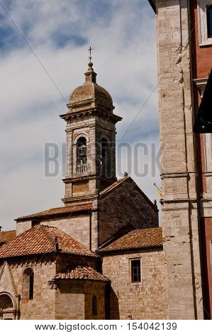 An old medieval roman church in San Quirico d'Orcia in Italy