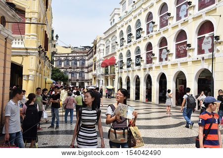 MACAU, CHINA - MAY 08, 2016 - Colonial buildings and tourists in Largo do Senado