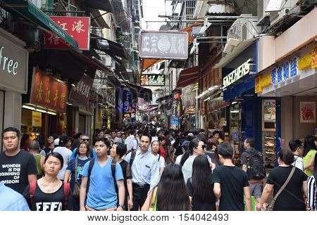 MACAU, CHINA - MAY 08, 2016 - Crowd of asian people and tourists on a busy street