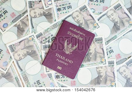 Thailand passport on the Japanese banknotes - Stock Photo