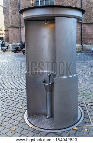 The Hague the Netherlands - October 29 2016: public urinal near Grote Kerk in The Hague
