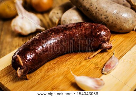 Czech traditional blood sausage and sausage meat on wood