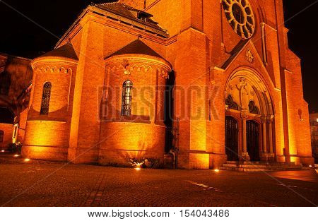 Neo-Gothic Catholic church during the night in Poznan