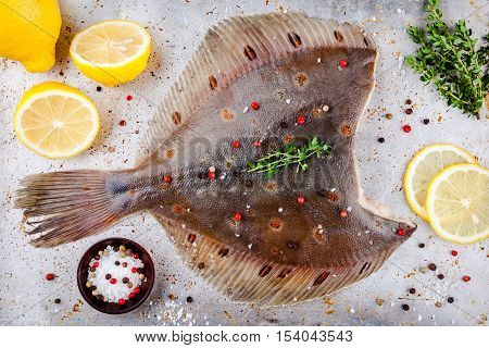 Raw Flounder Fish, Flatfish On Rustic Background