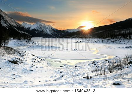 Colorful Sunrise in mountains. Winter Landscape, Rocky Mountains, Alberta, Canada