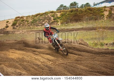 24 september 2016 - Volgsk, Russia, MX moto cross racing - Bike rider in a red suit, telephoto