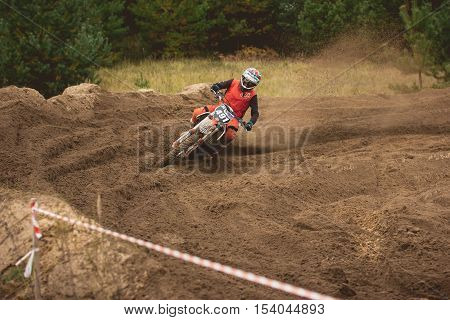 24 september 2016 - Volgsk, Russia, MX moto cross racing - dangerous maneuver motorcycle, telephoto