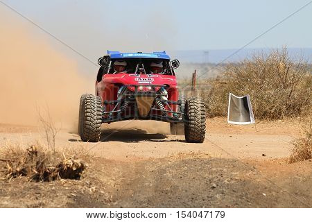 Front View Close-up Of Red Porter Rally Car Pull Away At Road Crossing