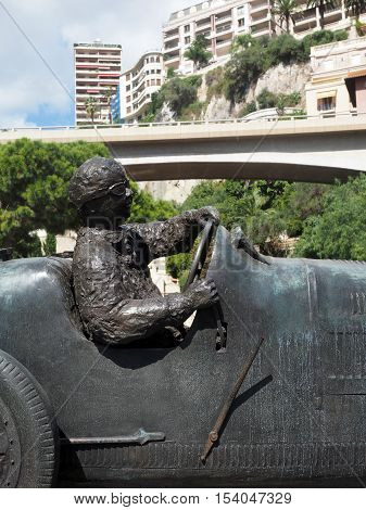 MONTE CARLO MONACO-SEPT. 22: A sculpture of race car and driver is seen in park Monte Carlo Monaco on September 22 2015.