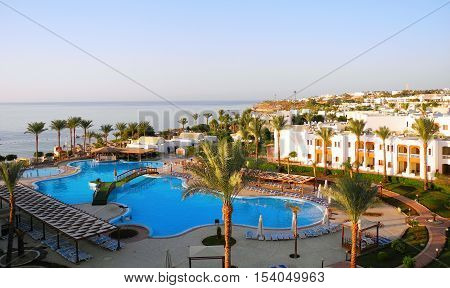 Sharm El Sheikh Egypt - August 22 2016: Swimming pool and palm trees at the resort in Sharm El Sheikh.