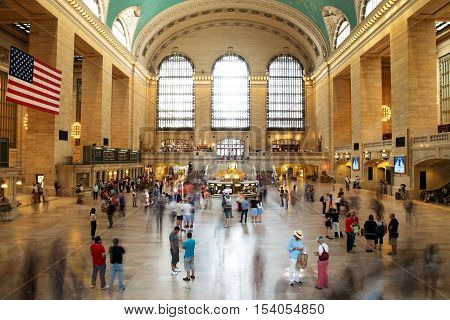 NEW YORK CITY - September 1: People commute during busy friday evening rush hour at Grand Central terminal on September 1 2014 in New York City. It is the largest train station in the world by number of platforms: 44 with 67 tracks.