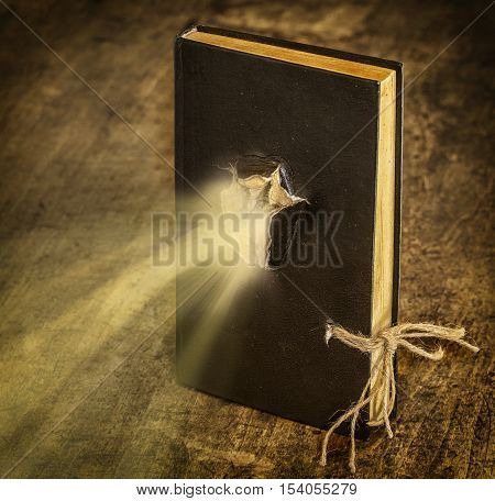 Magic Book closed on the rope emits light